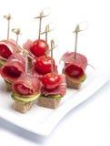 Canapes z pomidorem i bekonem Zdjęcia Royalty Free