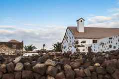Canarian Architecture. Village scene - typical canarian architecture - houses - cloudy sky - Fuerteventura, Canary Islands, Spain Royalty Free Stock Photos