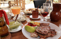 Canarian dinner or meal. Delicious meal or dinner of meat with salad, wine and traditional Canarian mojo sauce, Canary Islands, Spain Stock Photography