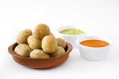 Canarian potatoes (papas arrugadas) with mojo sauce isolated. On white background royalty free stock photography