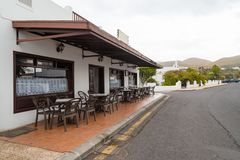 Canarian style street cafe in Lanzarote. Typical Canarian style building and street cafe, Lanzarote, the Canary islands, Spain royalty free stock image