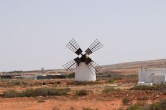Canarian traditional windmill in Fuerteventura island. Traditional windmill. It is in the inland, on the vulcanic island Fuerteventura. White architecture royalty free stock photos