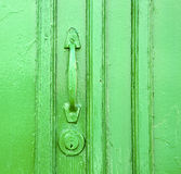 Canarias brass  green closed wood  abstract  spain. Canarias brass brown knocker in a green closed wood  door  lanzarote abstract  spain Stock Photo