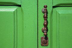 Canarias  lanzarote abstr  s. Canarias brass brown knocker in a green closed wood  door  lanzarote abstract  spain Royalty Free Stock Photos