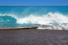 Canary Islands brown sand beach rough turquoise waves Stock Photos