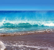 Canary Islands brown sand beach rough turquoise waves Royalty Free Stock Photo