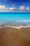 Canary Islands brown sand beach turquoise water. Canary Islands brown sand beach and tropical turquoise water Royalty Free Stock Photo