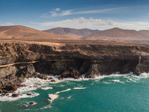 Canary Islands Cliffs, Mountains and Ocean. Sea cliffs and volcanic mountains at Caleta Negra bay. Ajuy, Fuerteventura, Canary Islands Royalty Free Stock Photo