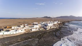 Canary Islands fishing village by volcanic stone beach Stock Image