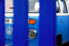 Canary Islands, Spain; January 19th 2019: blue and white old Volkswagen van behind blue fence stock photography