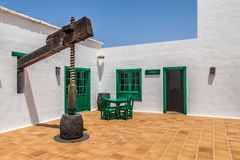 Canary Islands vine press. Lanzarote island is a superb place witch unique color palette. A beautiful place where you will fell like in a dream. Old vine Royalty Free Stock Photo
