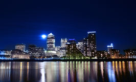 Canary wharf across the Thames at night. Long exposure by moonlight stock photo