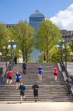 Canary Wharf banking aria. Stairs up to the square with walking and running people. London Royalty Free Stock Photo