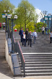 Canary Wharf banking aria. Stairs up to the square with walking and running people. London Stock Image
