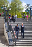 Canary Wharf banking aria. Stairs up to the square with walking and running people. London Royalty Free Stock Photography