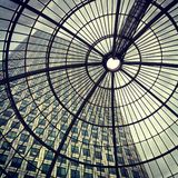 Canary Wharf - Cabot Square through Glass Roof. Shot though glass roof of 1 Cabot Sq at Canary Wharf, London Royalty Free Stock Image