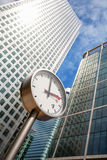 Canary Wharf Clock. London, UK. Clock and Skyscrapers at Canary Wharf, financial district in London. England Royalty Free Stock Photography