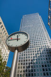 Canary Wharf clock and skyscrapers in the financial center  Stock Photos