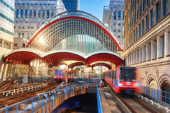 Canary Wharf, DLR station. DLR train leaving the station on a br Royalty Free Stock Photos