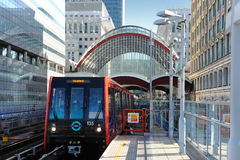Canary Wharf, DLR station. DLR train leaving the station on a br Stock Photos