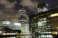 Canary Wharf, London. LONDON - AUGUST 6: Night shot of Canary Wharf, a major business district located in Tower Hamlets and one of London's two main financial Royalty Free Stock Photos