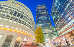 CANARY WHARF, LONDON - JUNE 29, 2015: Modern buildings at night. Stock Photos