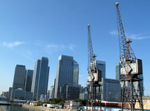 Canary Wharf in London's Docklands. Canary Wharf in Docklands with it's old cranes is the largest business development in East London, built on the site of the Stock Images