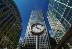 Canary Wharf. In London`s financial district was installed part of sculpture Six Public Clocks by Konstantin Grcic in 1999. London, United Kingdom - October 12 stock photography