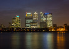 Canary Wharf in London. London, UK - September 24, 2013: Canary Wharf at night from across the Thames showing some financial buildings and offices litup against Stock Images