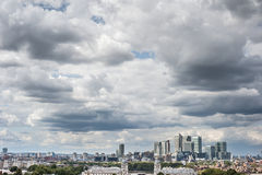 Canary Wharf in London under dramatic sky seen from Greenwich Park. Royalty Free Stock Photo