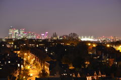 Canary Wharf and the Millennium Dome at night Stock Photo