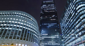 Canary Wharf office buildings. In corporate night scene in London royalty free stock photography