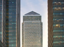 Canary Wharf office's windows lit up in the night. Stock Photos