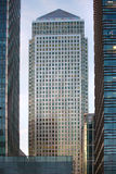 Canary Wharf office's windows lit up in the night. Stock Photography