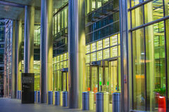 Canary Wharf office's windows lit up in the night. Royalty Free Stock Images