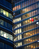 Canary Wharf office's windows lit up in the night. Stock Photo