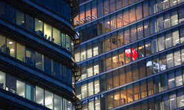 Canary Wharf office's windows lit up in the night. Royalty Free Stock Photo