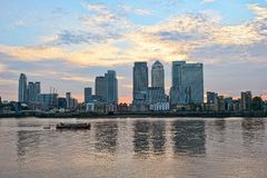 Canary Wharf, over Thames, London, England, UK. Canary Wharf at sunset, looking over the River Thames, from the east, London, England, UK, Europe stock photography