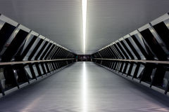 Canary Wharf Pedestrian Bridge. To Crossrail Place in London at night Stock Photo