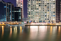 Canary Wharf riverside area at night Stock Image