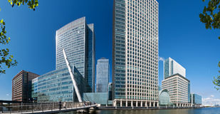 Canary Wharf Skyline. A extremely wide angle view of the skyscrapers of Canary Wharf with motion blured people in the background. (London, Canary wharf stock image
