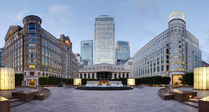 Canary Wharf skyline from Cabot Square, London. Wide angle panoramic view of the three tallest skyscrapers of the Canary Wharf skyline as viewed from Cabot Royalty Free Stock Photos