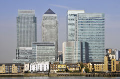Canary Wharf skyline beside River Thames Stock Photos