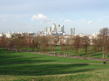 Canary wharf view from Greenwich. View of Canary Wharf business district from Greenwich park in London stock images