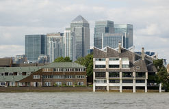 Canary Wharf viewed from the Thames at Poplar. Homes in the Poplar district of East London with the tall towerblocks of Canary Wharf on the Isle of Dogs in Royalty Free Stock Photo