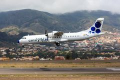 Canaryfly ATR 72 at Tenerife. A Canaryfly ATR 72 lands at Tenerife Norte Airport los Rodeos Royalty Free Stock Photo