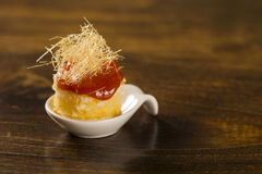 Canasta cheese mousse with guava jelly and creamy cornmeal cake in a spoon. Stock Photography