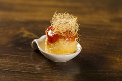 Canasta cheese mousse with guava jelly and creamy cornmeal cake in a spoon Royalty Free Stock Photo