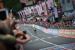 Canazei, Italy May 24, 2017: Pierre Rolland Cannondale-Drapac Pro Cycling Team  pass the finish line and win the stage. After a hard montain stage of Tour of Royalty Free Stock Photography