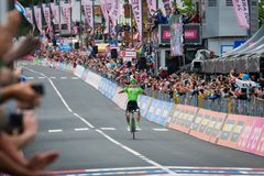 Canazei, Italy May 24, 2017: Pierre Rolland Cannondale-Drapac Pro Cycling Team  pass the finish line and win the stage. After a hard montain stage of Tour of Stock Images